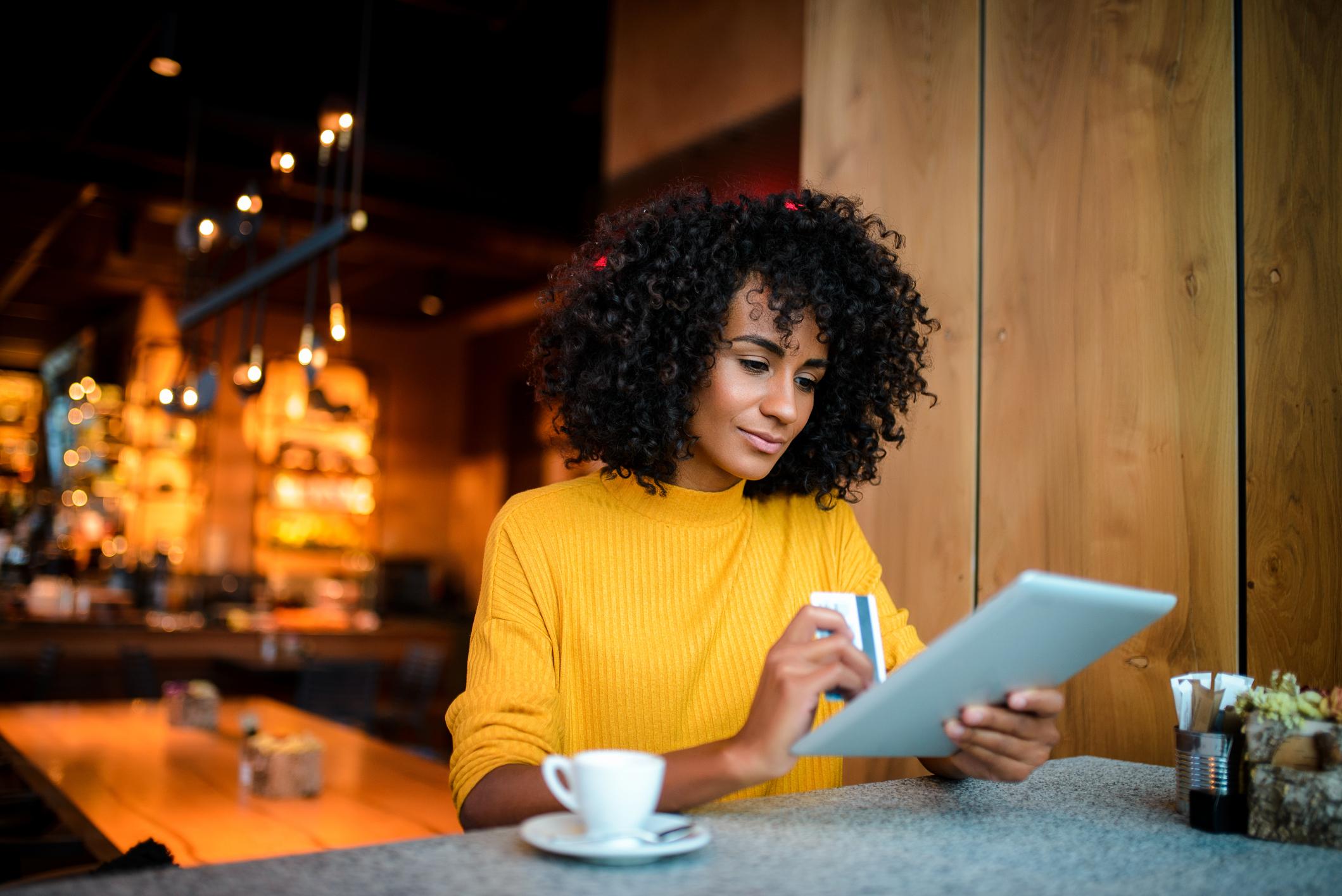 Woman looking at credit card information